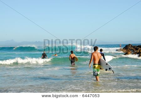 Surfers in Byron Bay