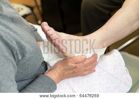 Podologist In Preparation Of A Treatment Of The Feet