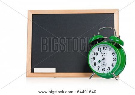 Big green alarm clock with chalkboard, isolated on white background
