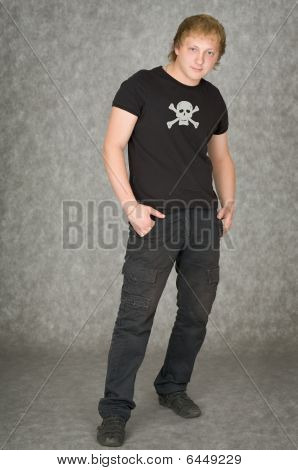 Man In A T-shirt With Pirate Symbolics