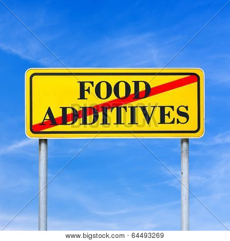 Food additives prohibited - conceptual image with the words Food additives crossed through in red on a yellow traffic sign against a sunny clear blue sky. poster