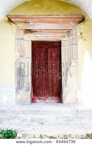 Old woodcarved red door