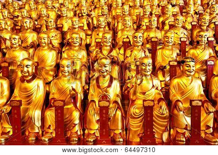 Gold statues of the Lohans in Longhua buddhist temple, Shanghai, China