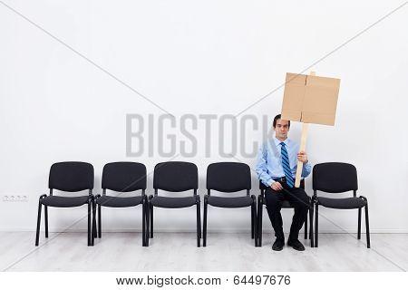 Businessman Protesting Alone