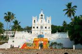 Beautifully lit Mae De Deus Church situated in Saligao (Goa, India). poster