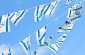 Israeli flags showing the Star of David hanging proudly for Israel's Independence Day (Yom Haatzmaut) poster