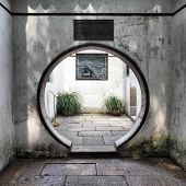 Round doorway in ancient Yu Yuan Garden in Shanghai, China  poster