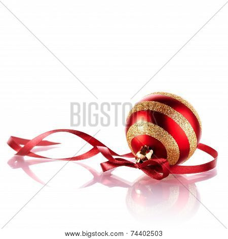 Striped New Year's Ball With A Red Ribbon.