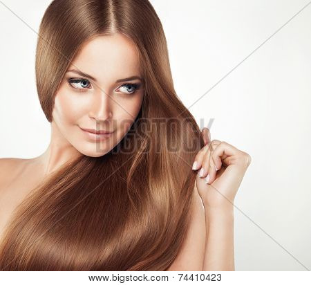 Beautiful girl with brown hair . Long straight hair Shine with health.