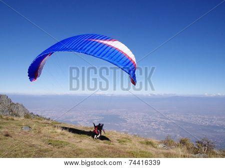 Blue Paraglider Over City Sofia, Bulgaria