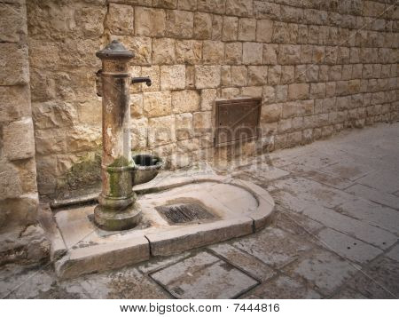 Rusty fountain in Oldtown of Molfetta. Apulia.