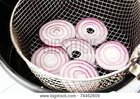 Onion in deep fryer, closeup