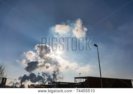 vent an industrial plant with smoke. symbol photo for environmental protection and ozone.