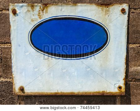 Textured  Blue Rusty Metal Background, With Crude Painted Oval Shape.
