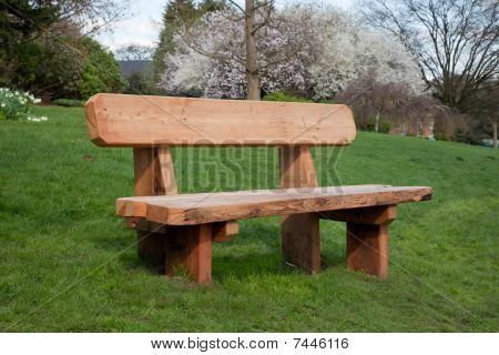 Wooden Bench On Grass