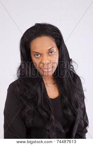 Black woman looking thoughtful