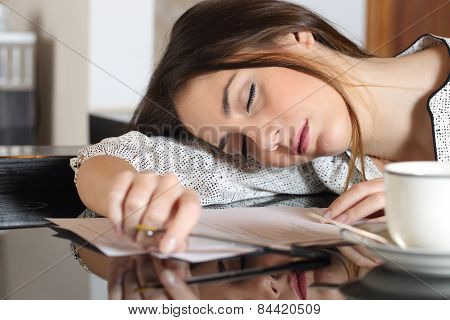 Tired Overworked Woman Resting While Writing Notes