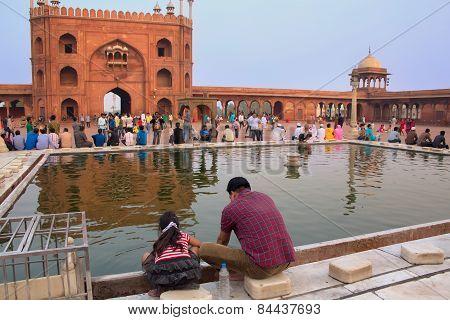 Delhi, India - November 5: Unidentified Man With Unidentified Girl Sits At Jama Masjid On November 5
