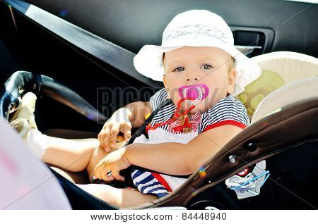 Baby Girl Sitting In Car