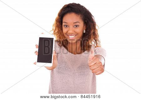 African American Woman Showing A Mobile Phone And Making Thumbs Up