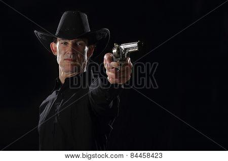 Gunslinger aims pistol