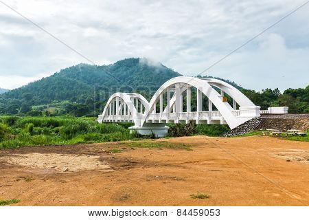 White Railway Bridge And Mountain In Background