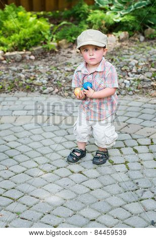 Little Boy Holding Handfuls Of Colorful Easter Eggs