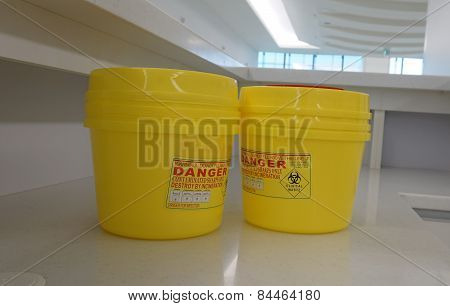 Container for hazardous waste in hospital. It can contain sharpen item chemical or toxic material. poster