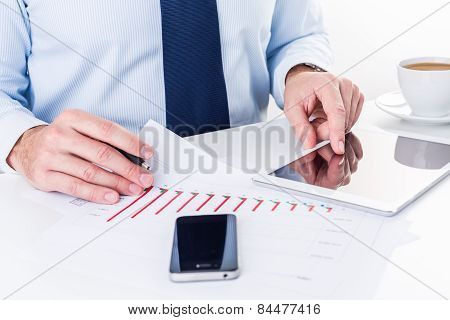 Businessman working on a digital tablet.