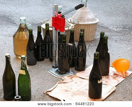Pour The Wine In The Backyard With The Carboy And Glass Bottles
