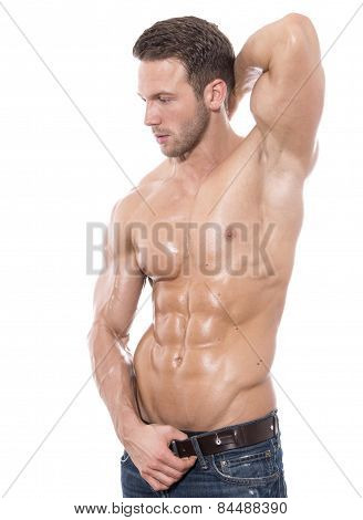 handsome young bodybuilder showing of his fit body and muscles poster