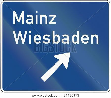 German sign: Motorway exit announcement to the cities Mainz and Wiesbaden. poster