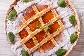 Italian crostata with apricot jam close up on the table. horizontall top view poster