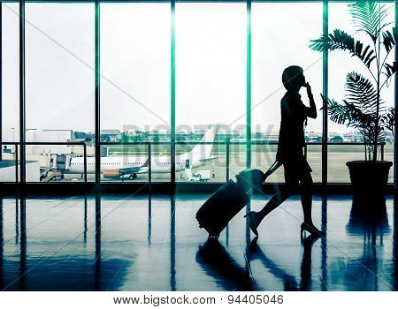 Business Woman At Airport - Silhouette Of A Passenger