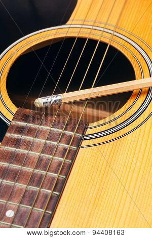 pencil on guitar