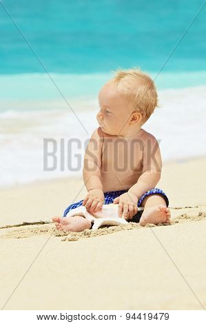 Funny Portrait Of Child Playing With Sea Shell On Beach