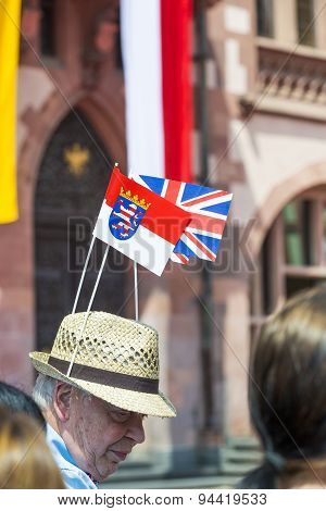Man Waits For The Queen Elizabeth Ii With A Hat And British And Hesse Flag