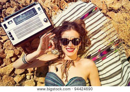 Beautiful Girl On A Stony Beach