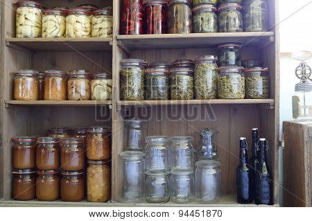 preserving jars with vegitables and fruits in an old shelf poster