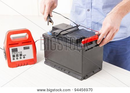 Charging car battery with electronic charger