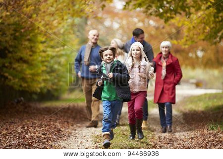 Multl Generation Family Walking Along Autumn Path