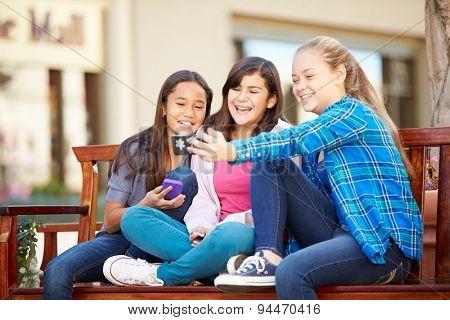 Group Of Girls Taking Selfie On Mobile Phone