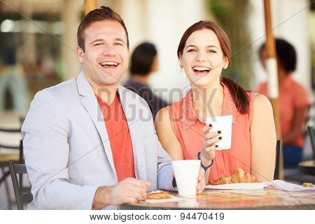 Couple Enjoying Snack In Caf\x81_