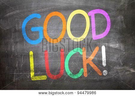 Good Luck written on a chalkboard poster