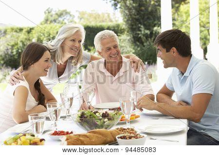 Parents and Adult Children enjoying Al Fresco Meal