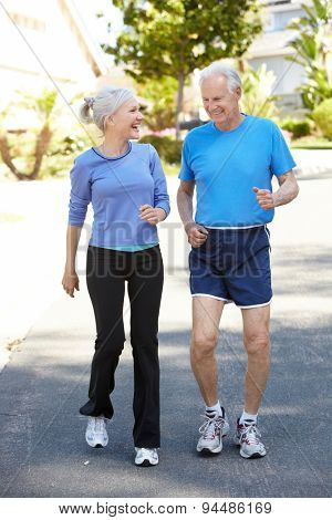 Elderly man and younger woman jogging