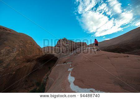 Woman Walking On A Slickrock Cave Point Escalante Utah