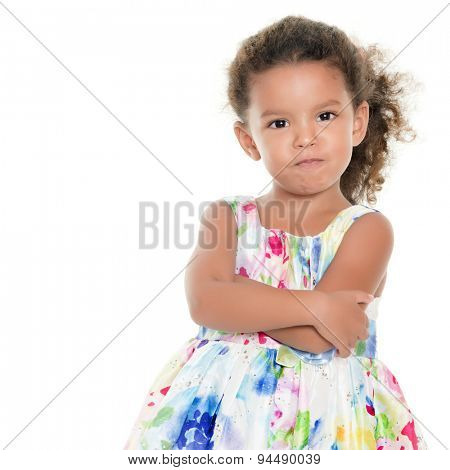 Cute and funny small hispanic girl making an angry face isolated on white