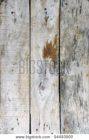 Old wooden planks arranged vertically.