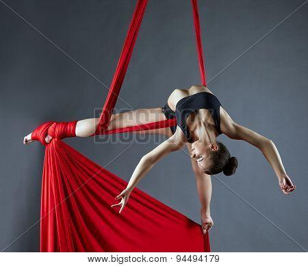 Elegant female dance posing on aerial silks